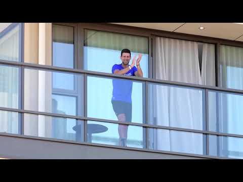 Djokovic given boost by fans' Serbian dance