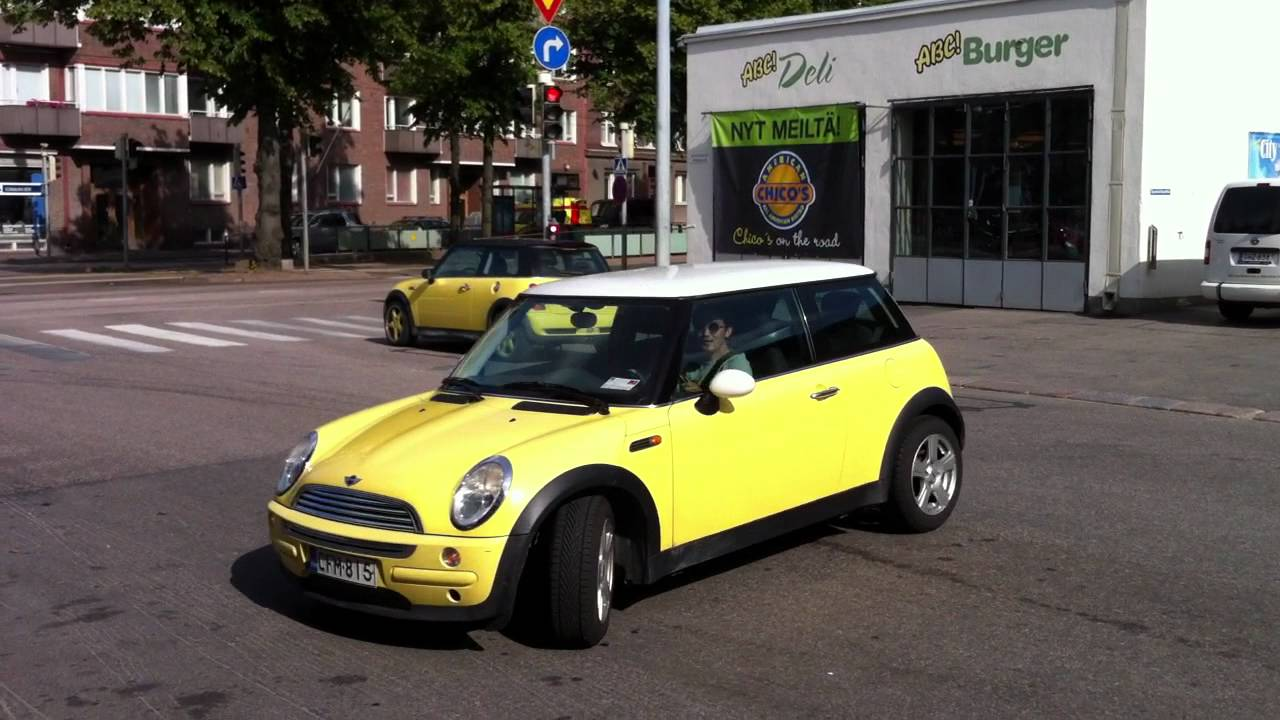Two Yellow Mini Coopers