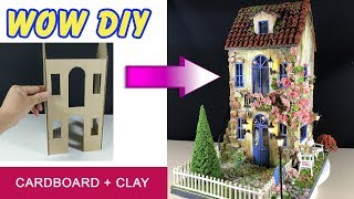 Make a cardboard house using cardboard and Das Clay
