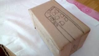 распаковка iPhone 4S из бумаги