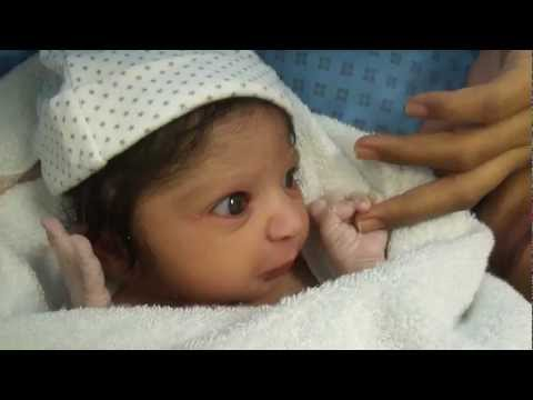 Cute Newborn Baby half an hour old.