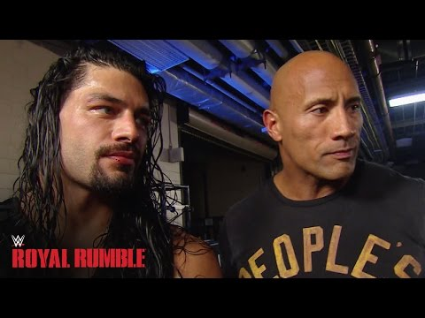 Roman Reigns celebrates with The Rock after winning the Royal Rumble Match - WWE Network