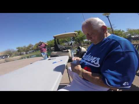 Dodgers Tommy lasorda signs ball spring training