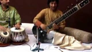 manu seen play sitar