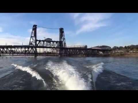 Scenic boat cruising along the Willamette river in Portland, Oregon