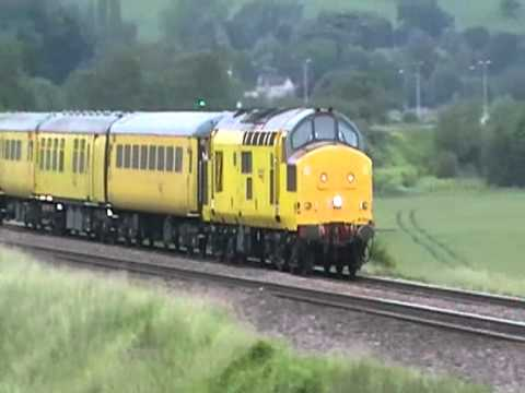 Network Rail 97303 thrashes past Newton St Loe, Bath
