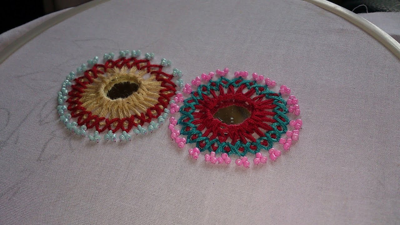 Hand embroidery designs mirror work