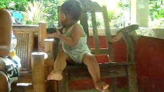 baby sitting on a rocking chair