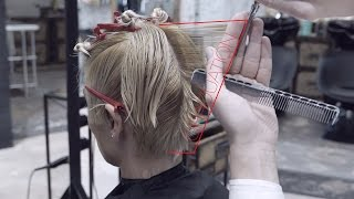 short women's haircut, combination of graduation and layers
