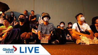 Hong Kong protesters stage silent sit-in at Yuen Long MRT station | LIVE