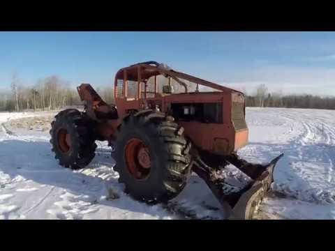Timberjack 230 Log Skidder - Pulling Skids