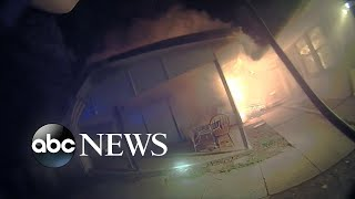 Bodycam captures cop's fiery home rescue