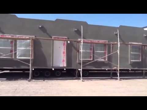 Santa fe style exterior in the making champion homes youtube for Adobe style mobile homes