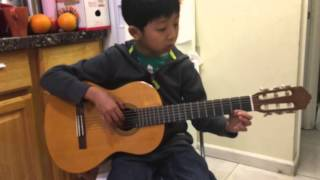 8 year old boy play guitar romance perfectly