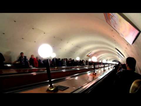 Deep escalator down to a subway station in Moscow, Russia