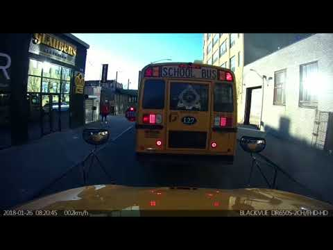 Yeshiva Bus Drives On Sidewalk To Pass Other Buses