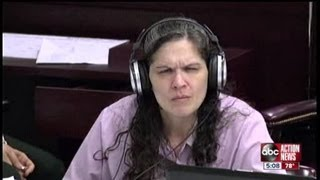 DeeDee Moore listens to her own interrogations with police in her trial