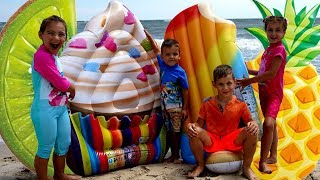 Funny kids play on the beach