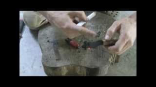 How to light a candle with a firesteel or empty lighter