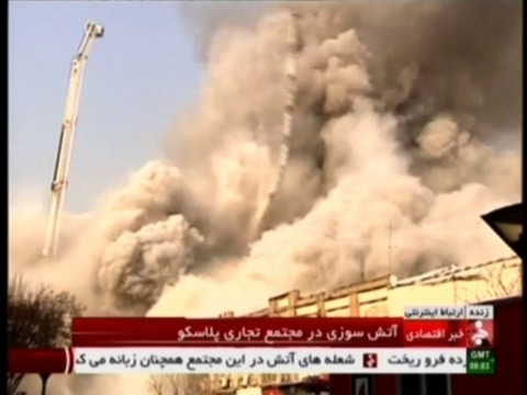 Raw: High-Rise Tower On Fire In Iran Collapses
