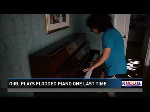Girl plays flooded piano one last time