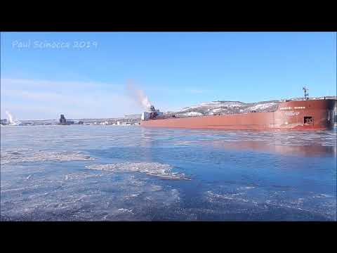 A little sea smoke, ice, waves,the perfect Duluth Day, Mesabi Miner departing with coal