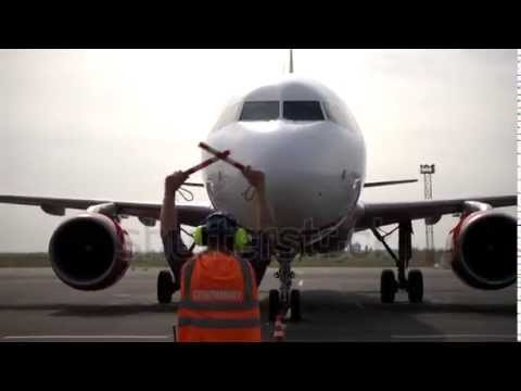Airport ramp agent worker supervisor shows direction parking aircraft, landed on Airbus A319 A320