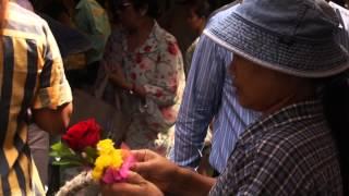 Flower vendor selling religious flowers in the Market.....Bangkok Thailand