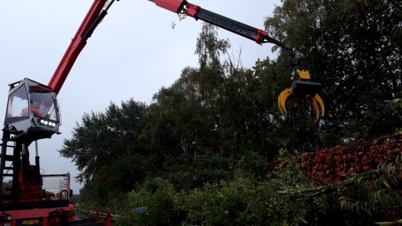 Grapple saw for tree removal - massive truck crane by GMT Equipment