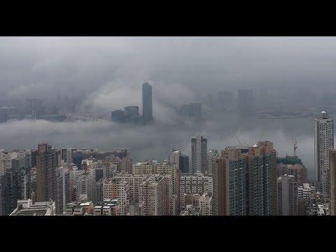 Timelapse sea mist swirls over Hong Kong's Victoria Harbour