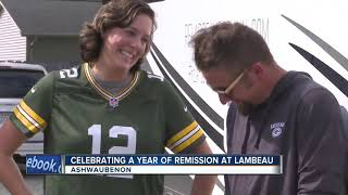 Packers fan celebrates first year cancer free at game