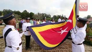 Raising of ceremonial flag to mark the start of Sultan of Johor's coronation ceremony