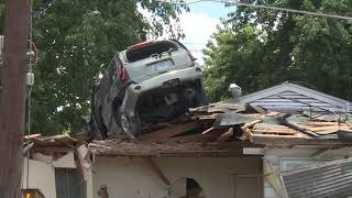 RAW VIDEO: Speeding car jumps, lands on house roof