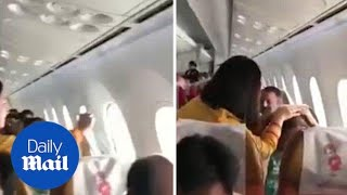 Air India Passengers panic after WINDOW detaches on plane - Daily Mail