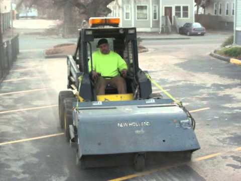 Cleaning up sand from a parking lot