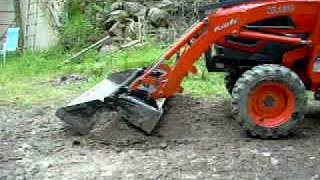 Four-in-one bucket operation on Kioti CK30 tractor