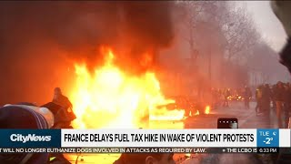 France delays fuel tax hike in wake of violent protests