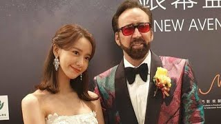 YoonA joins Hollywood actor Nicolas Cage for photos at the Macau International Film Festival