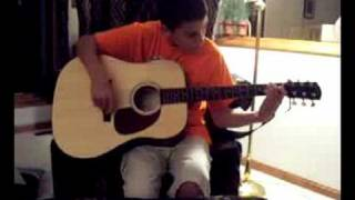 Little Brother Playing Guitar