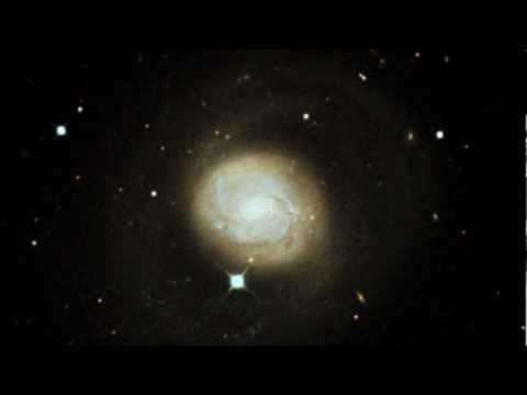 Hubble. Zooming in on Messier 77. HD