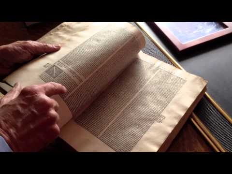 David Leroy shows off his antique books