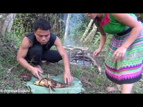 Primitive technology - Survival skills: fishing at river and cooking fish - Eating delicious