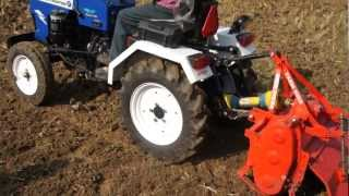 Farmer Mini Tractor working with rotavator