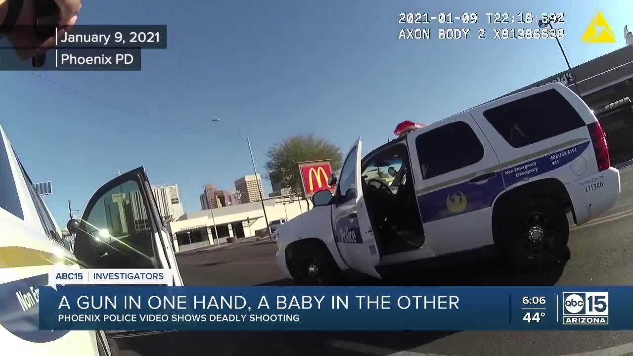 Download Phoenix police release video of a man shot while holding a baby