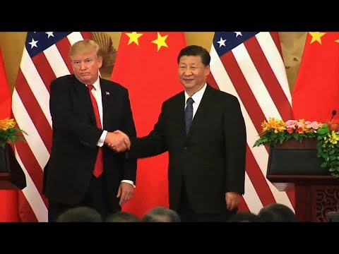 In China, Trump Talks Trade & North Korea, Ignoring Climate Change & Crackdown on Human Rights