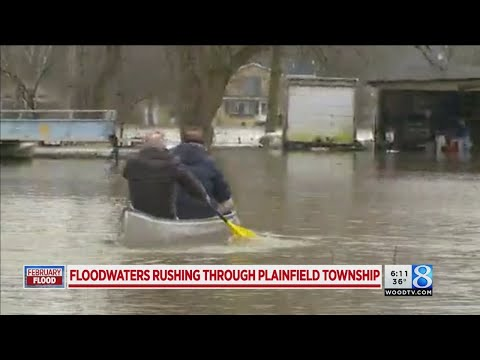 Floodwaters rushing through Plainfield Township