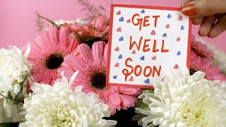 A get well soon message card with a beautiful bouquet of pink and white flowers