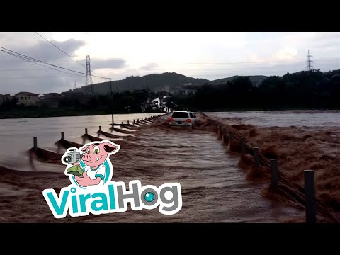 Crossing a Flooded River in a Toyota || ViralHog
