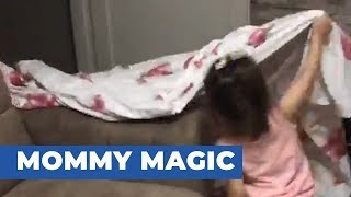Toddler Confused After Mom Disappears Behind Falling Blanket