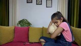 Pretty young girl playing doctor-doctor with her cute teddy bear at home - kids lifestyle in India
